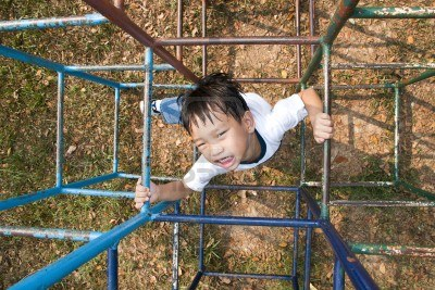 13249318-asian-kid-playing-in-playground[1]